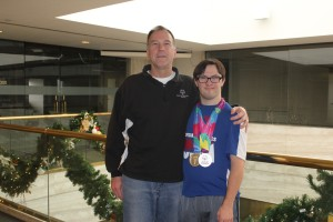 Mark Nichol with his son, Chris Nichol, who won two silver medals in the Special Olympics World Games last summer.